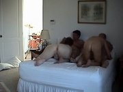 A blonde and a brunette milf have a swinger foursome