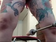 Tattooed girl fucked the machine good