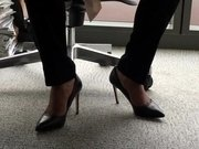 Candid twist her stiletto heels